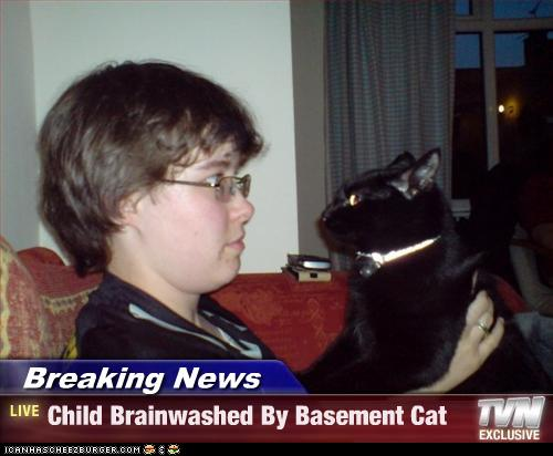 uh43048,1274276759,funny-pictures-cat-brainwashes-child