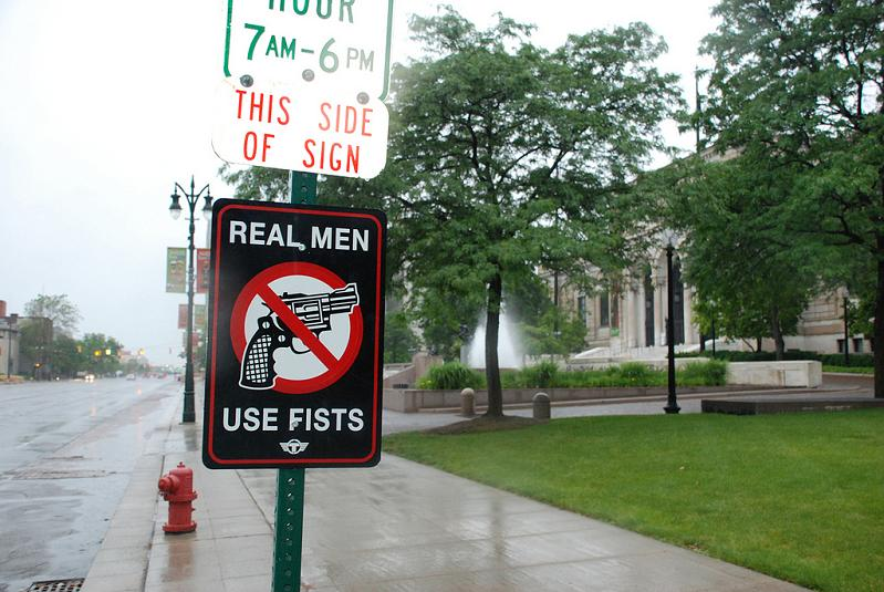 uh43048,1276867151,real-men-use-fists-anti-gun-street-sign-trustocorp