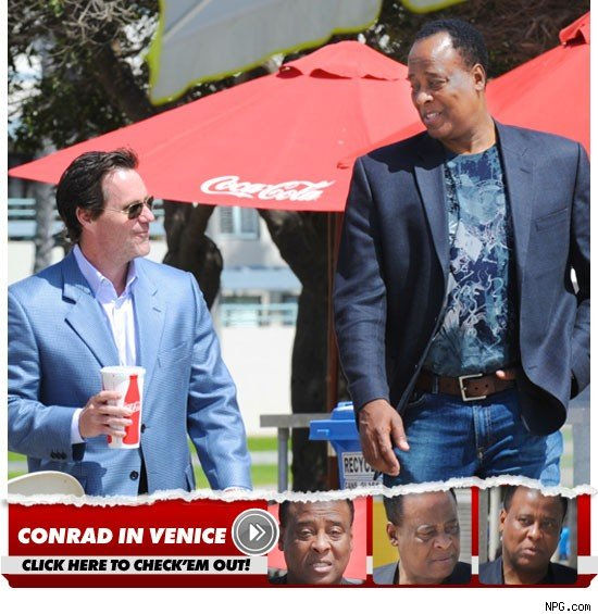 uh60207,1270486495,0405 conrad murray photo launch