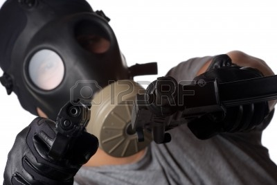 8578896-a-man-wearing-a-gas-mask-pointin