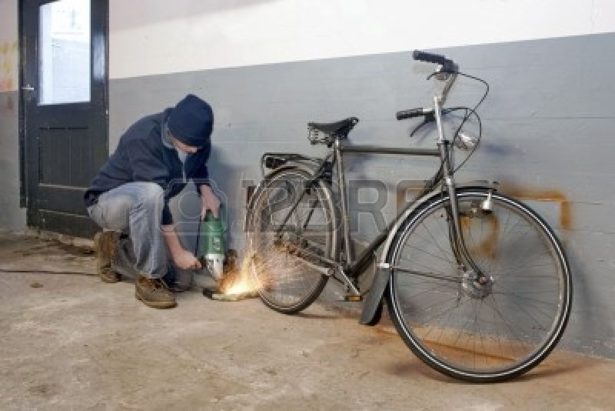 6552729-bicycle-thief-busy-breaking-the-