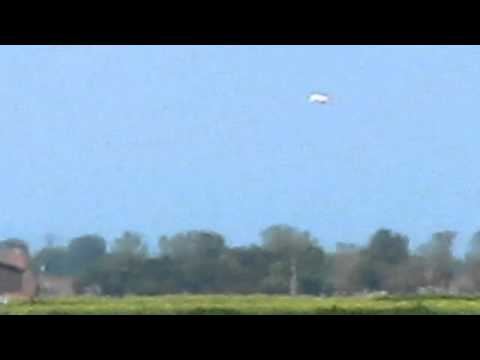 Youtube: UFO close to Viking Town hovering over farmland roadway