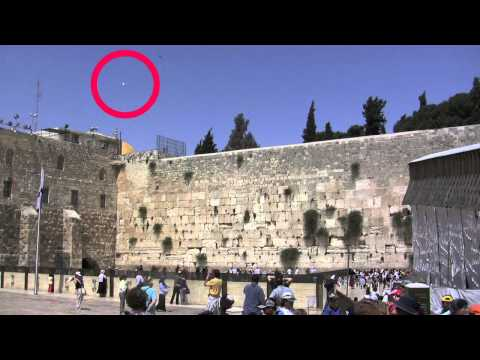 Youtube: Spirit Orb or Ghost caught on tape - Holy wall - Israel - UFO sightings Dec. 16th.
